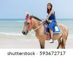 Young Woman Riding Horse In...