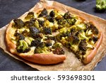 sliced pizza with broccoli and... | Shutterstock . vector #593698301