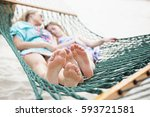 barefoot and relaxed family... | Shutterstock . vector #593721581