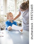 child learning from his teacher ... | Shutterstock . vector #593721605