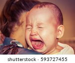 mom soothes baby. the baby is... | Shutterstock . vector #593727455
