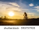 silhouette of a woman rides a... | Shutterstock . vector #593757935