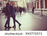 couple embracing on a walk... | Shutterstock . vector #593773571