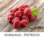 fresh raspberry on a wooden... | Shutterstock . vector #593783114