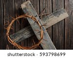 crown of thorns on wood desk.... | Shutterstock . vector #593798699
