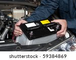 a car mechanic replaces a... | Shutterstock . vector #59384869