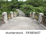 Stone path in a thailand water garden - stock photo