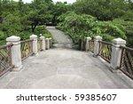 Stone path in a thailand water garden - stock photo