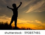 silhouette of kid stretch the...