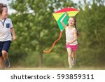 girl and boy flying a kite and... | Shutterstock . vector #593859311