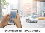 hand using smartphone searching ... | Shutterstock . vector #593869859