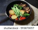 vegetable grill on pan  | Shutterstock . vector #593870057