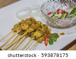 satay   chicken satay and with... | Shutterstock . vector #593878175