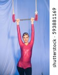 Small photo of Acrobatic artist hanging from fabrics, on stage