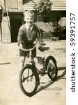 Vintage photo of boy with bicycle (early fifties) - stock photo