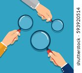 hands holding a magnifying... | Shutterstock .eps vector #593920514