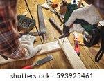 man drills the wooden plank | Shutterstock . vector #593925461