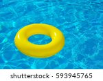 inflatable tube floating in... | Shutterstock . vector #593945765