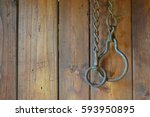 old chain hanging on the wooden ... | Shutterstock . vector #593950895
