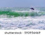 surfer riding a huge wave... | Shutterstock . vector #593956469