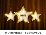 retro light sign. three gold... | Shutterstock .eps vector #593969501