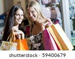 happy shoppers  | Shutterstock . vector #59400679