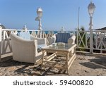 Two cane armchairs and a table on the terrace against Atlantic. Tenerife island, Canaries - stock photo