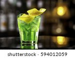 glass of cocktail green fairy... | Shutterstock . vector #594012059