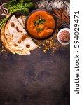 spicy chicken tikka masala in... | Shutterstock . vector #594029471