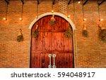 Wood Arch Door On Brick Wall...