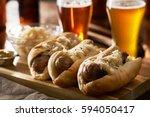three german bratwursts and sauerkraut with beer