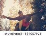 couple in the park. the girl... | Shutterstock . vector #594067925