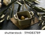 green olive in green ceramic... | Shutterstock . vector #594083789