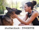 Stock photo young happy woman with is belgian malinois dog 59408998