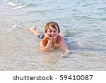 young boy enjoys lying at the... | Shutterstock . vector #59410087
