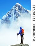 hiker with backpacks reaches... | Shutterstock . vector #594107159