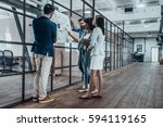 working as a team. full length... | Shutterstock . vector #594119165