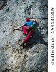 man is climbing a vertical wall | Shutterstock . vector #594131309