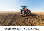 tractor preparing land for... | Shutterstock . vector #594167969