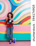 outgoing woman hearing song... | Shutterstock . vector #594174905