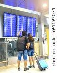 asian traveler looking flight... | Shutterstock . vector #594192071