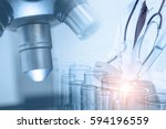 doctor with microscope  medical ... | Shutterstock . vector #594196559