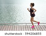 asian sport woman jogging on... | Shutterstock . vector #594206855