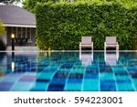 swimming pool in resort and... | Shutterstock . vector #594223001