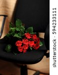 flowers on office chair.  | Shutterstock . vector #594233111