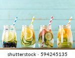 variety of fruit infused detox... | Shutterstock . vector #594245135