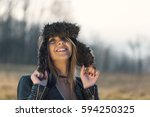 happy young woman with hat in...   Shutterstock . vector #594250325
