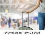 Small photo of close up soft focus woman hand touching baggage for check in at counter in airport:tourism girl travel in holiday:teenager tour for make a trip and now she go aboard concept:departure arrival flight