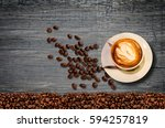 coffee cup and coffee beans on... | Shutterstock . vector #594257819