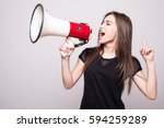 pretty girl shouting into... | Shutterstock . vector #594259289